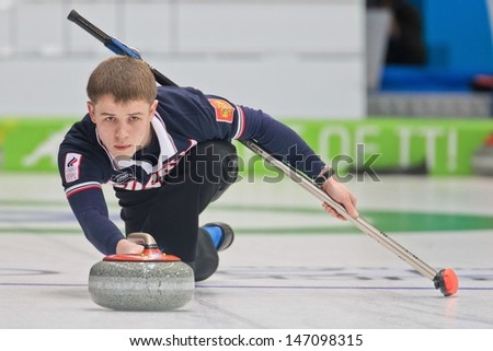 INNSBRUCK, AUSTRIA - JANUARY 20 Mikhail Vaskov (RUS) and his partner from the Czech Republic beat team Estonia and Italy in the curling mixed doubles by 10:3 on January 20, 2012 in Innsbruck, Austria. - stock photo