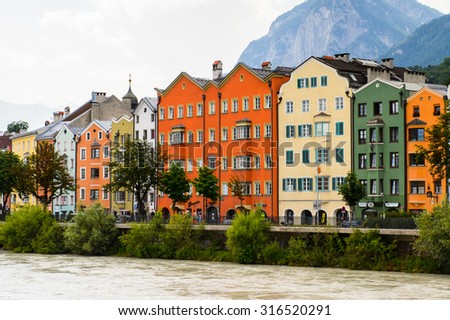 INNSBRUCK, AUSTRIA - JULY 4, 2015: Colorful Architecture on the coast of the Inn river of Innsbruck, Austria. Innsbruck is the capital city of the federal state of Tyrol (Tirol)