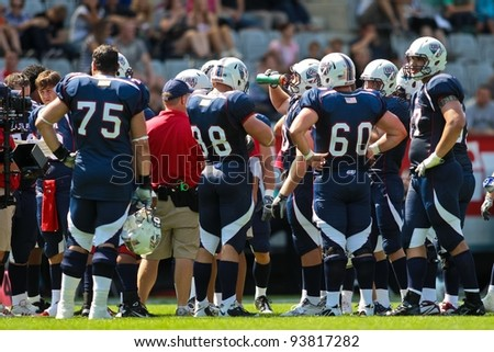 INNSBRUCK, AUSTRIA - JULY 8: Team USA in the huddle at the Football World Championship on July 8, 2011 in Innsbruck, Austria. USA wins 61:0 against Australia.
