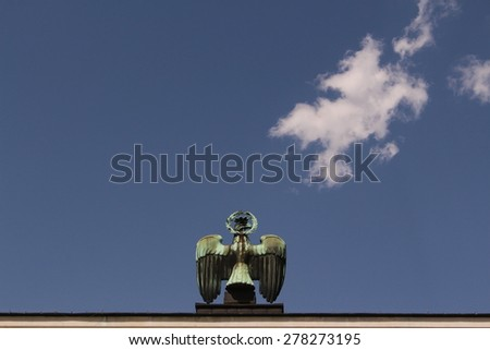 INNSBRUCK, AUSTRIA - MAY 13: Copper Tyrolean Eagle on the top of WW II Liberation Monument of Austria at Eduard Wallnoefer Platz on May 13, 2015 in Innsbruck. - stock photo