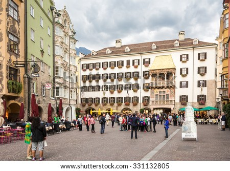 INNSBRUCK, AUSTRIA - SEPTEMBER 22: Tourists at the famous golden roof in Innsbruck, Austria on September 22, 2015. Innsbruck is the capital of Tyrol. - stock photo