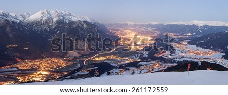 Innsbruck, Axams and Kematen at night, photographed from mount Rangger Koepfl, Innsbruck, Tyrol, Austria - stock photo