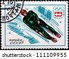 INNSBRUCK SWITZERLAND - Olympic games - CIRCA 1976: A stamp printed in Russia shows a bobsled skating, circa 1976. - stock photo