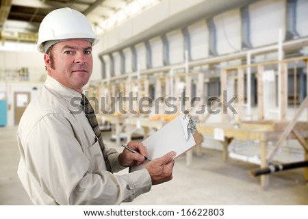 Inpector performing an audit of a plumbing factory.