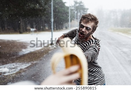 Insane zombie hunting for bananna like wild - stock photo