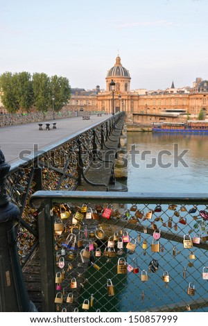 Inscribed romantic love padlocks on the Pont Des Arts bridge  in Paris France. - stock photo