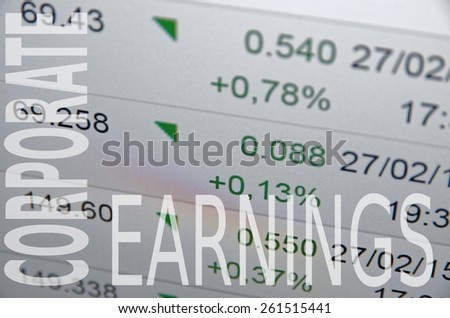 "Inscription ""Corporate earnings"" on PC screen. Trading terminal with ticker. - stock photo"