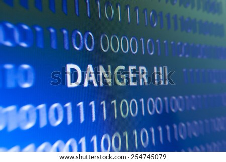 Inscription danger on blue computer screen or monitor - stock photo