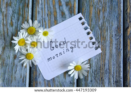Inscription Good Morning with wild flowers