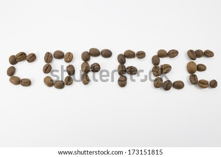 inscription laid out from coffee grains on the isolated background