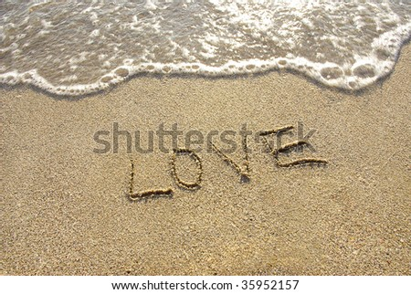 Inscription love on the beach - stock photo