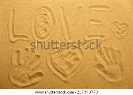 inscription love on the sand. Top view. blur - stock photo