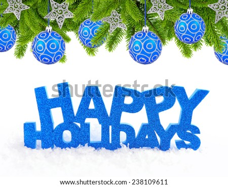 Inscription of happy holidays is on snow with christmas decorations - stock photo