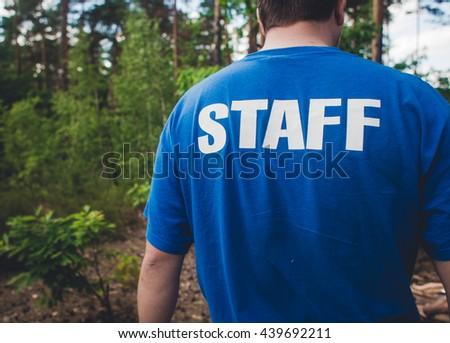 inscription on shoulders staff - stock photo