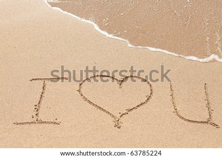 Inscription on the beach Love you