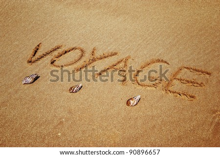 Inscription on wet sand voyage