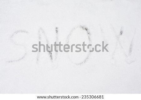 inscription snow on snow-covered ice, the inscription on the snow - stock photo