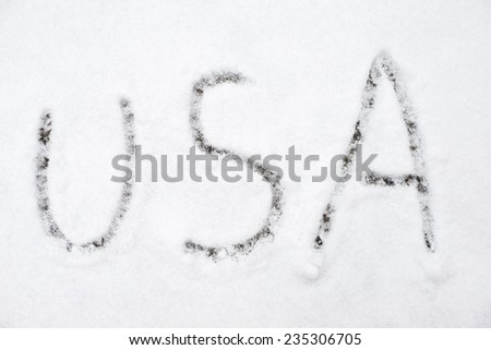 inscription usa on snow-covered ice, the inscription on the snow - stock photo