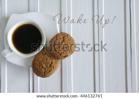 Inscription Wake Up with cup of coffee