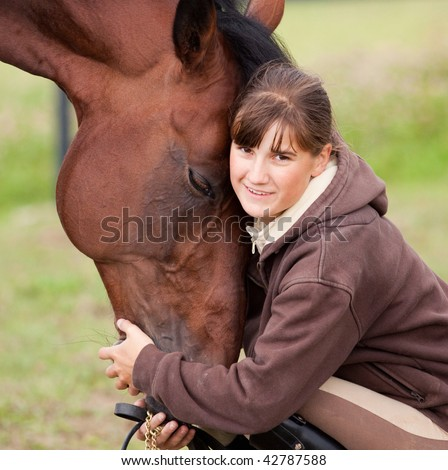 inseparable - young girl and bay horse in field - stock photo