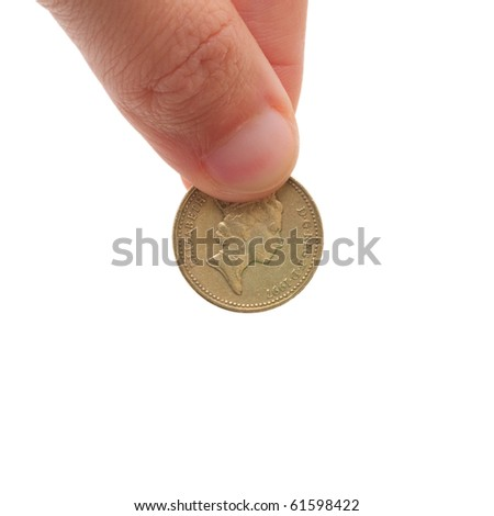 Insert coin in a piggy bank or video game coin op arcade - stock photo
