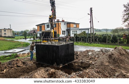 insert concrete septic septic tank to earlier dug down - stock photo