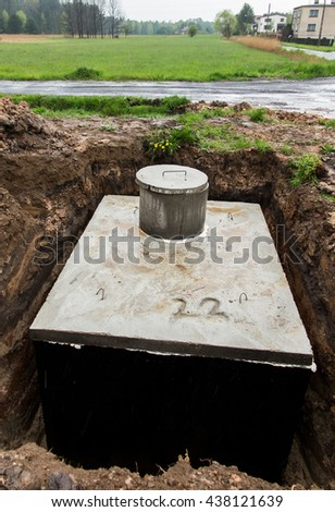 insert concrete septic  tank to earlier dug down - stock photo