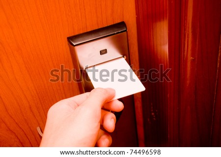 Insert keycard in door - stock photo