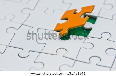 inserted into the puzzle the last element - stock photo