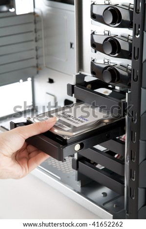 Inserting Hard drive in to bare computer case, assembling of a new PC, Hard Drive Label is hand made by me! - stock photo
