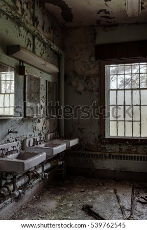 Inside a bathroom in the abandoned Willard Asylum for the Insane / State Hospital in Willard, New York.