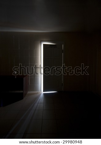 Inside a dark room with half-opened doors - stock photo