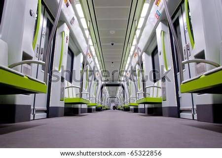 Inside a green empty subway car - stock photo
