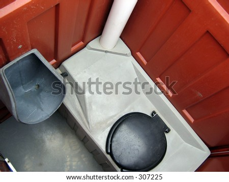 inside a portable toilet - stock photo