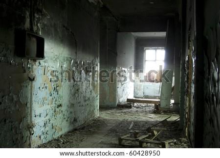 Inside abandoned old hospital - stock photo