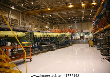 Inside Aerospace Production Facility Wing In A Jig - stock photo