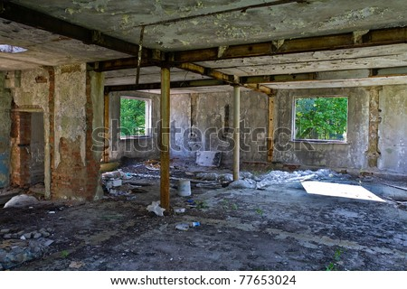inside an abandoned and broken house - stock photo