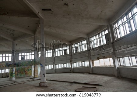 Inside an abandoned deserted cluttered industrial building