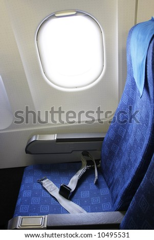 Inside an airplane in econmy class - stock photo