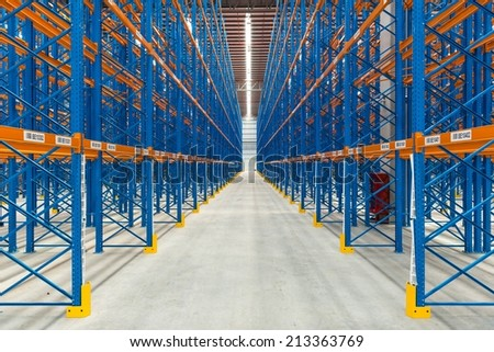 Inside an empty generic large warehouse with rack in place, taken in door - stock photo