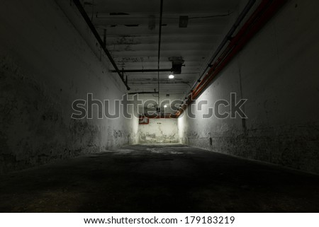 inside an old industrial building, basement with little light
