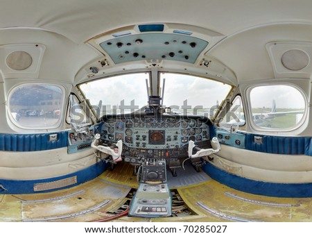 inside an old turboprop cockpit wide angle - stock photo