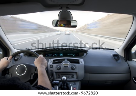 Inside car view at high speed. - stock photo