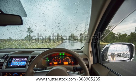 inside car view on the rainy day - stock photo