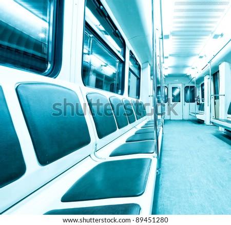inside contemporary wagon of train in metro - stock photo