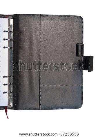 Inside cover of leather organizer with penholder on white background - stock photo