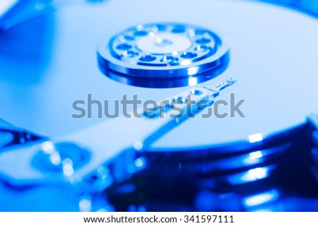 Inside hard drive cylinder and head macro blue color