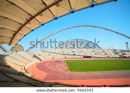 Inside Khalifa sports stadium in Doha, Qatar where the 2006 Asian games were hosted and location for the proposed 2016 Olympic Games (wide angle lens distortion on edges) - stock photo