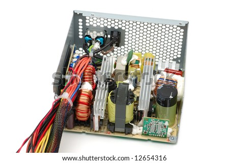 Inside of a computer power supply over white background