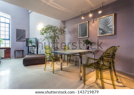 Inside of a dining room with modern pictures
